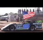 Nick Anvelink carries the U.S. flag as he drives around the track during the Shawano Speedway's season opener on Saturday. Drivers who won a 2019 title received the honor, with Anvelink having won the Late Model class last summer. Morgan Rode | NEW Media