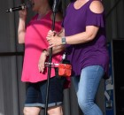 Stephanie Reinl, left, and Anna Snyder of The Cougars band perform during the opening Music by the River concert of the summer June 26 at East Side Beach in Oconto Falls.  Warren Bluhm | NEW Media