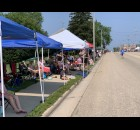 Green Bay Street was filled with tents as residents and visitors braved the heat to watch the Fourth of July parade pass in Bonduel on July 4.  Luke Reimer   NEW Media