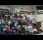 Fans throw new stuffed animals toward the basketball court during halftime of the Bonduel varsity boys basketball game on Thursday.