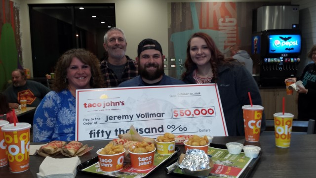 Taco John's $50,000 winner, Jeremy Vollmar, celebrates his good fortune at the new Taco John's in Wittenberg. From left are parents Chris and Jim Vollmar, Jeremy Vollmar and girlfriend Chesney Rohrbeck.