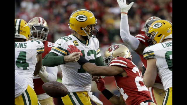 San Francisco defensive back K'Waun Williams, right, knocks the ball away from Green Bay quarterback Aaron Rodgers during the first half of Sunday's NFC Championship Game in Santa Clara, California. The Packers recovered the fumble, but were topped 37-20.