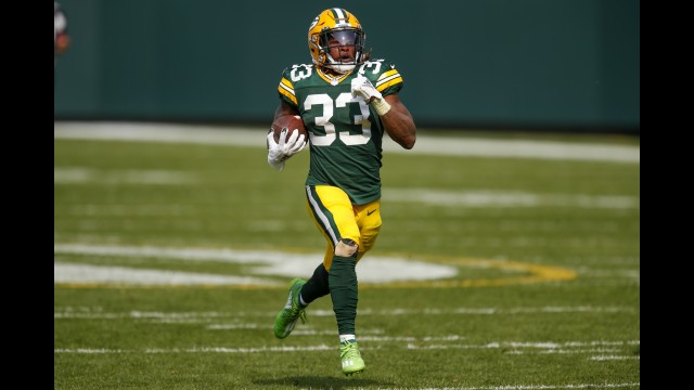 Green Bay Packers running back Aaron Jones runs for a 75-yard touchdown during the second half of Sunday's game against the Detroit Lions in Green Bay.