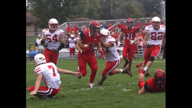 Shawano's Brayden Dickelman, center, runs with the football during a Bay Conference home game against Seymour on Sept. 21. Dickelman made the all-conference first team as a running back and honorable mention team as a linebacker. He was also tabbed the Offensive Back of the Year in the Bay.  Morgan Rode | NEW Media