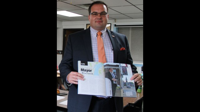 """In August 2018 then-Mayor James Beaton displays an """"American Funeral Director"""" magazine profile written about his dual role as Gillett mayor and funeral director. Beaton now faces 13 charges of theft in a business setting. File   NEW Media"""