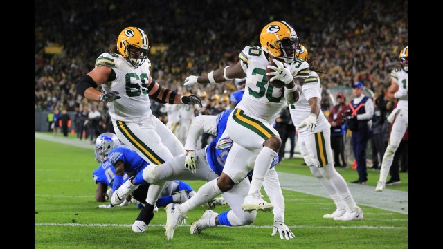 Packers running back Jamaal Williams scores a touchdown during Monday's victory over the Lions in Green Bay.  Jim Leuenberger
