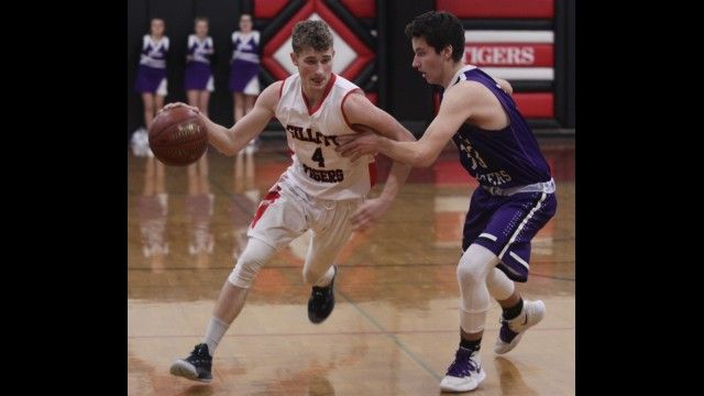 Gillett's Wyatt Herzog, left, drives with the basketball during Friday's Marinette & Oconto Conference victory over Niagara in Gillett.