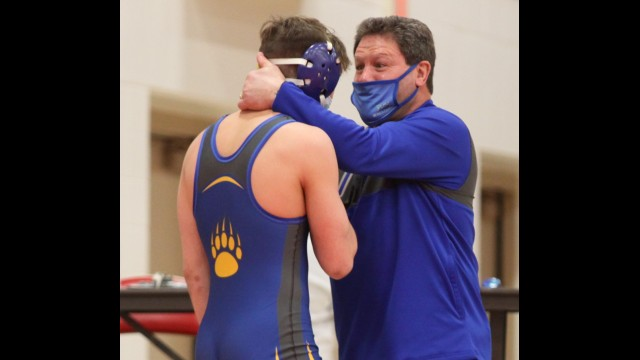 Bonduel wrestling head coach Chris Rank, right, gives Max Sokolski a final pep talk before his first state match on Feb. 13 at Wausau East High School. Rank decided to retire from coaching after serving as the team's head coach the past 23 seasons.  Morgan Rode | NEW Media