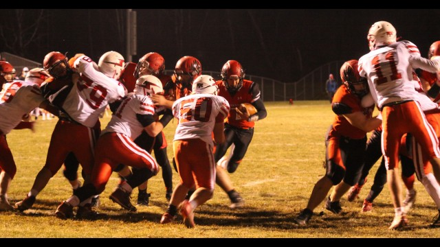 Shawano's Gage Timm, center, and runs through an opening to score a touchdown during the team's playoff win over Seymour on Thursday in Shawano.  Morgan Rode | NEW Media