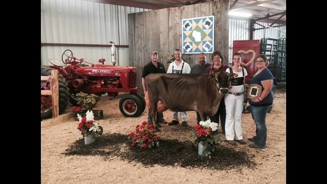 Milk-n-More Tequila Naomi stands with the Wussow family after a showing at the Shawano County Fair. Naomi has received many accolades as a show cow, and now she has received the 2019 Wisconsin Cow of the Year honor.  (Contributed)