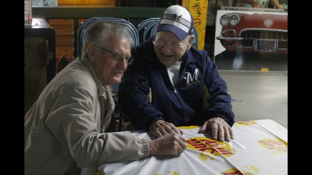 "Floyd ""Twig"" Hartwig, right, shares a laugh with his longtime friend and former worker Dale Pleshek during a surprise 90th birthday party in April 2017 at the Sun Drop museum behind the Twig's bottling factory.