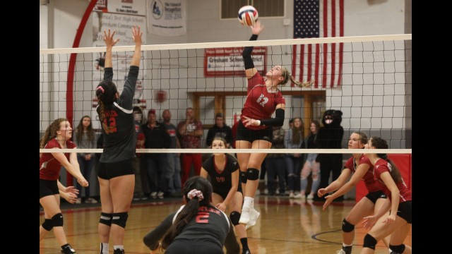 Gresham's Karisa Nietzer, center, spikes the ball during a Division 4 regional final against Bowler on Oct. 26 in Gresham. Nietzer made the Central Wisconsin Conference-North Division first team and was named the Player of the Year in her senior season.  Morgan Rode | NEW Media