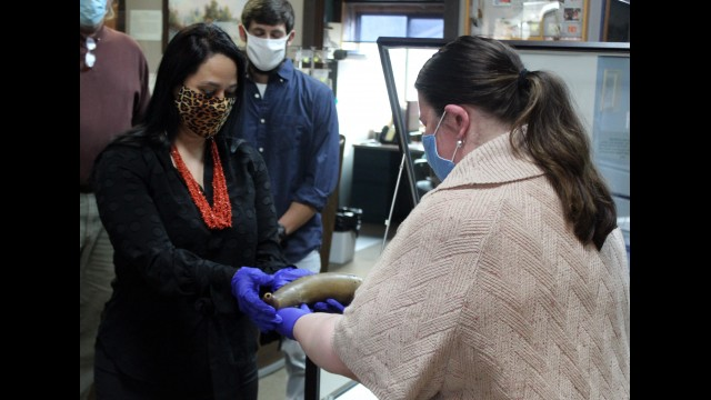 Stockbridge-Munsee Tribal President Shannon Holsey accepts a powder horn owned by the late John W. Quinney from Anna Cannizzo, assistant director of the Oshkosh Public Museum, during a private ceremony held Nov. 19 at the Arvid E. Miller Library and Museum. The Oshkosh museum had previously loaned the horn to the tribe a year ago, and tribal cultural representatives petitioned the museum to repatriate the object, as Quinney was a respected lobbyist for the tribe.  (Lee Pulaski | NEW Media)