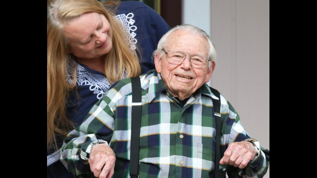 Lana Holland offers birthday wishes to Maurice Jury at their Shawano home.  Carol Ryczek | NEW Media