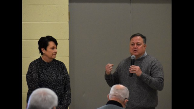 Penny Helmle, left, is recognized by Oconto County Health & Human Services Director Mike Reimer during the Feb. 18 county board meeting for her 39 years of service to the county. Warren Bluhm | NEW Media