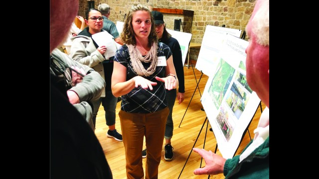 Tara Meyer discusses the possible options for a new bridge over The Channel (Shawano Creek) at County Road HHH on the east side of Shawano. Meyer, of the engineering consulting firm Strand Associates, was one of the consultants and engineers present at a public meeting Wednesday to discuss options for the bridge replacement. The project is scheduled for 2022.   Greg Mellis | NEW Media
