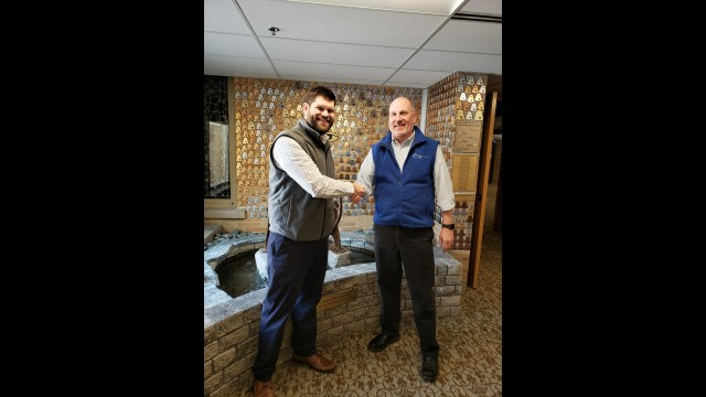Justin Cieslewicz, Homme Inc. of Wisconsin's new executive director, left, shakes hands with Steve Seybold, who retired from the position at the end of February. Contributed