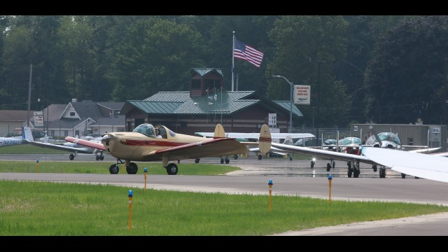 Ercoupe vintage airplanes line up at Shawano Airport before taking off for Clintonville and Wausau on July 23. The airport and the Lighthouse, a neighboring restaurant, hosted 21 planes and pilots, friends and family members of the Ercoupe Owners Club. The small planes were built between 1937 and 1970 and billed as a plane anyone can fly.   Carol Ryczek   NEW Media