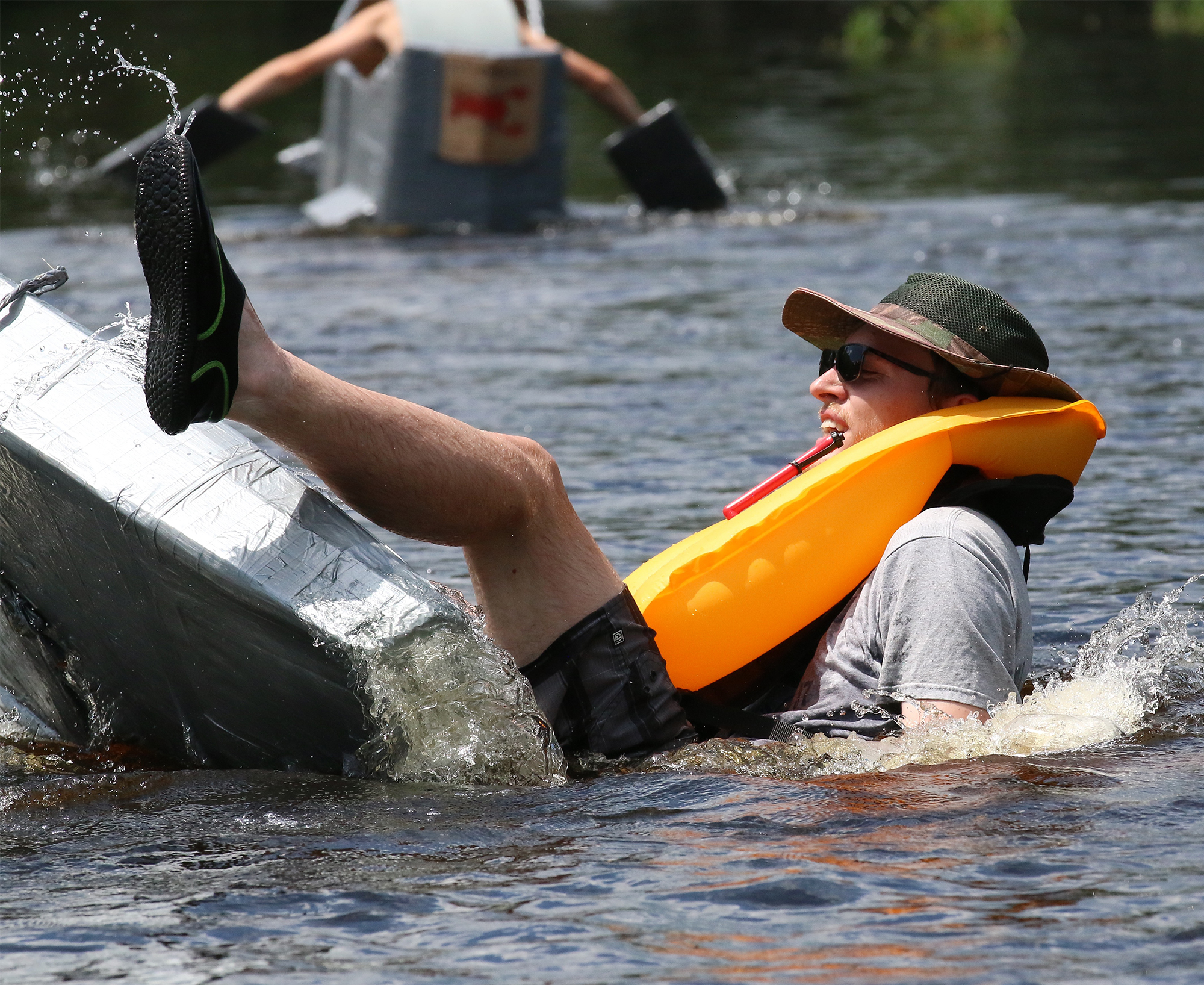 Jason Dietrich, West Bend, had a few stability problems with his cardboard and duct tape raft at the annual Cardboard Boat Regatta at the Tilleda Falls Campground on Saturday. The event requires sailors to create a craft entirely out of cardboard, with waterproofing and structure provided by rolls of duct tape.<br />Carol Ryczek | NEW Media