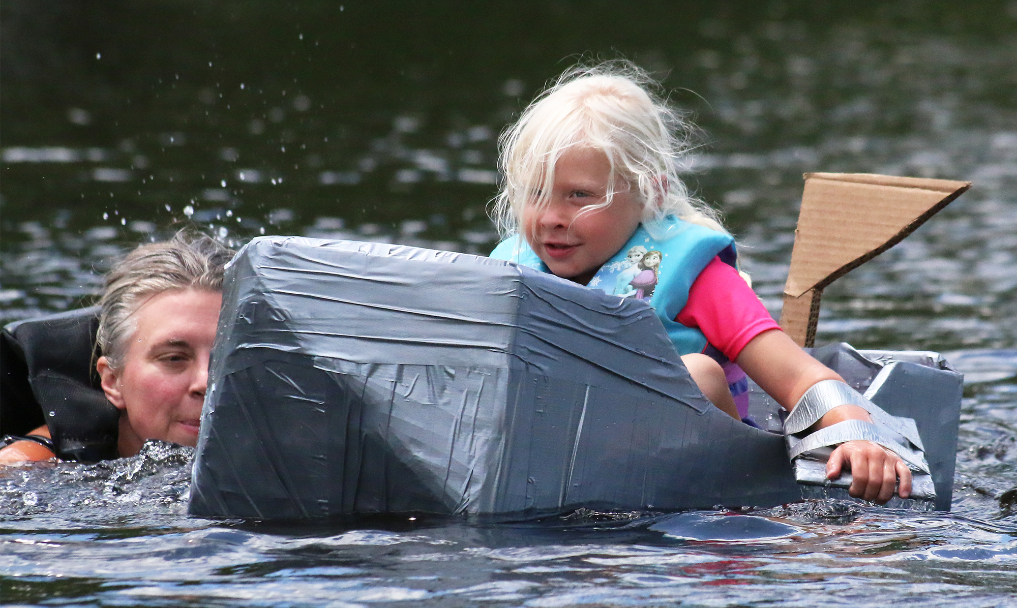 Kaylie Olson gets an assist from her mother as she paddles toward shore.Carol Ryczek | NEW Media