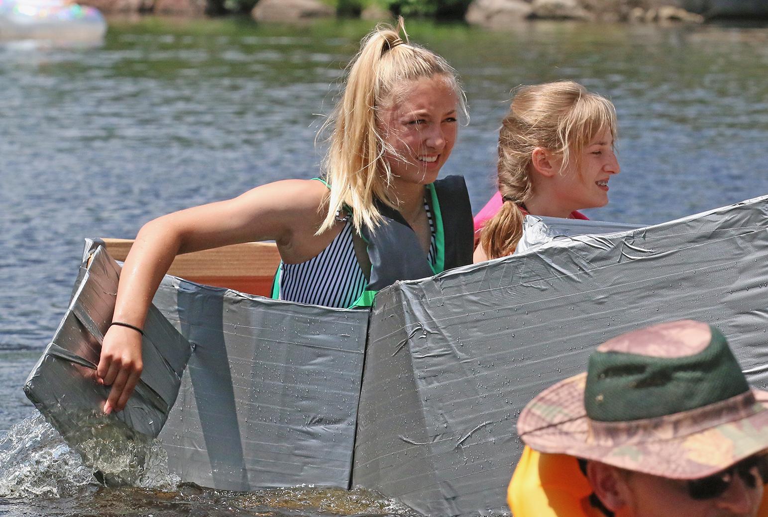 Paige Danen, left, and Sami Danen came in second in the cardboard regatta at Tilleda Falls — a small, private campground near Gresham.Carol Ryczek | NEW Media