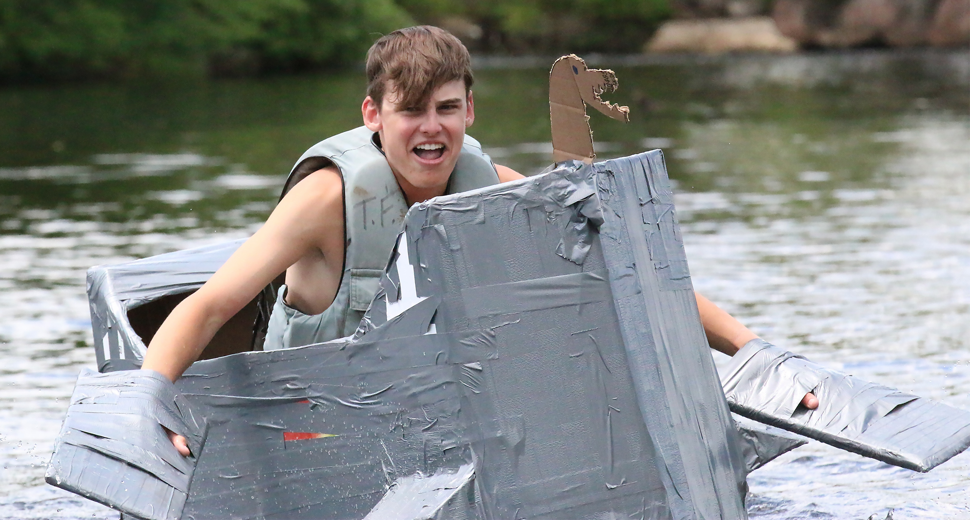 Max Giebe took first place in his Viking-inspired dragon boat, the S.S. Mbrags, at the Tilleda Falls Campground Cardboard Boat Regatta on Sunday.Carol Ryczek | NEW Media