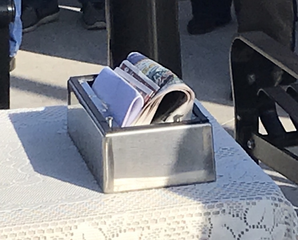 Among the items placed in the time capsule are the dedication program, an American Legion poppy, the Panther Pride newsletter, a flash drive, a flip phone, a phone book, stamps commemorating the Appolo 11 50th anniversary, a Witt's Piggly Wiggly flyer, an Oconto Falls centennial coin, a sheet about 2019 prices and pop culture, a Legion Riders coin, and last week's edition of the Oconto County Times Herald.